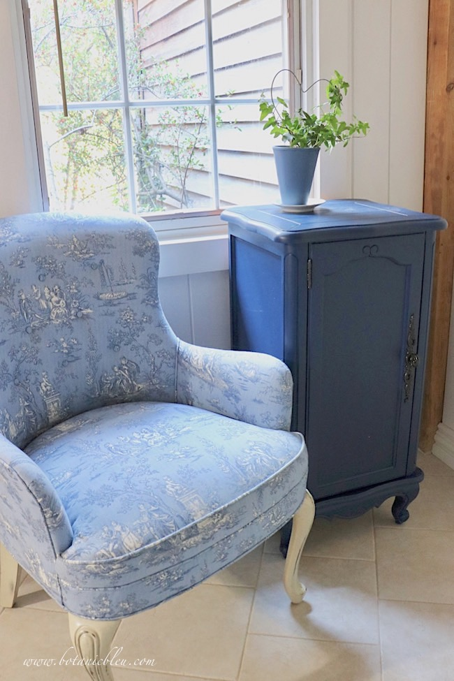 Add French Country style to a room with a small Provence style cabinet painted navy to go with the blue toile chair