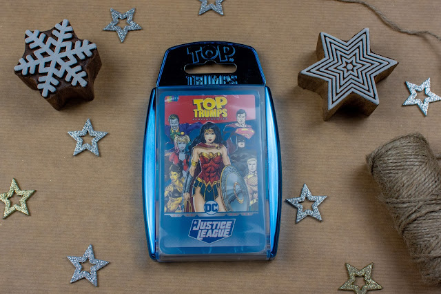A Top Trump box in metallic blue with a set of DC Comics' Justice League Top Trump cards in
