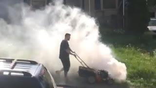 Mower Blowing White Smoke