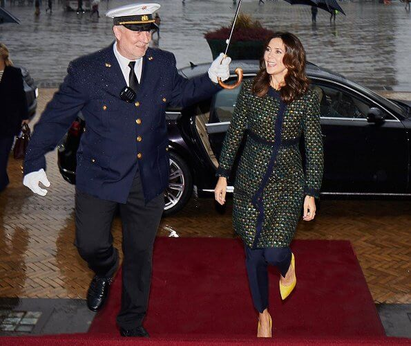 Crown Princess Mary wore a tweed coat from Prada, and yellow suede pumps from Gianvito Rossi