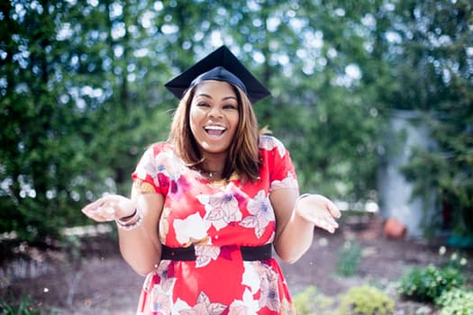 Woman expressing excitement after barging a masters degree