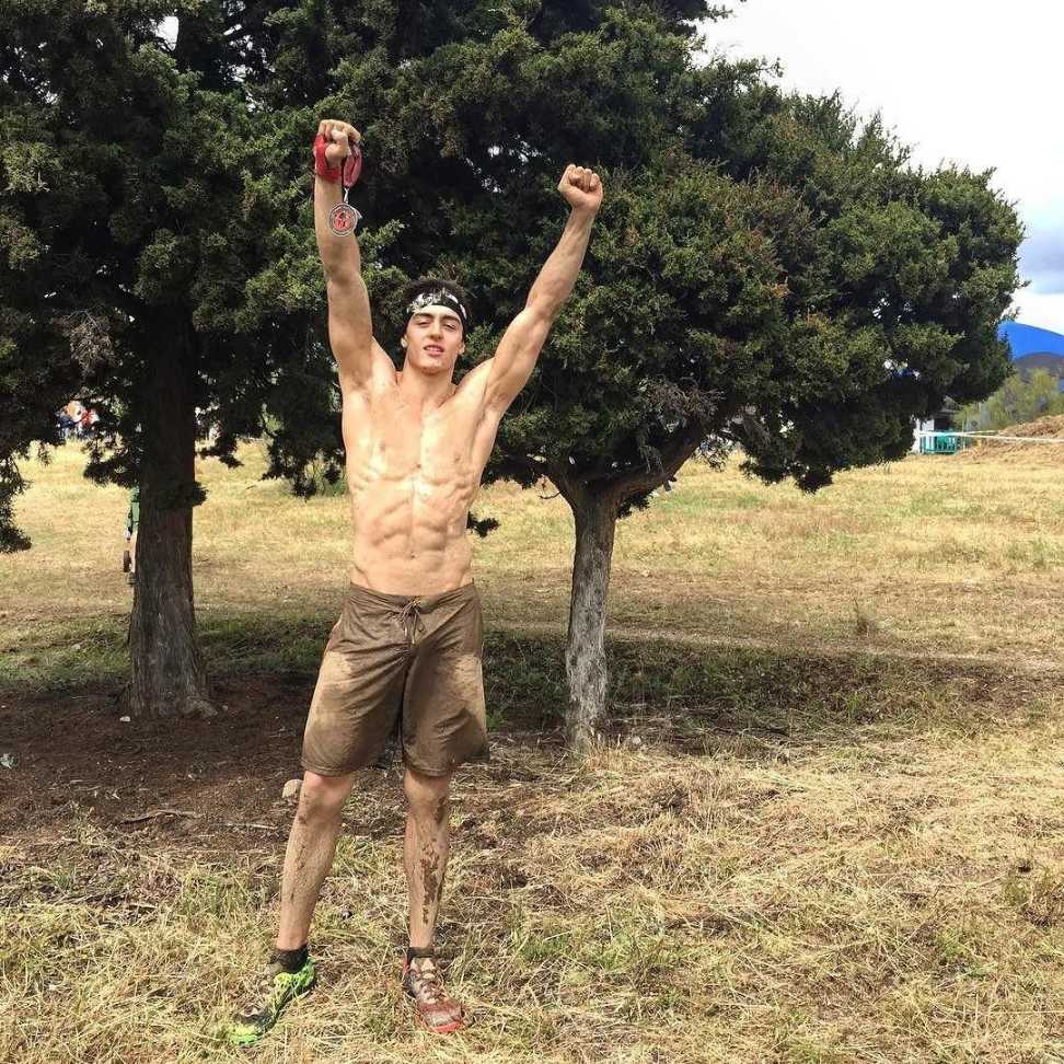 fit-shirtless-jock-jumping-outdoors-nature-muscle-body
