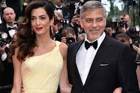 """Amal e George Clooney cuore d'oro, """"adottato"""" giovane rifugiato iracheno"""