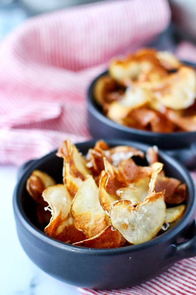 Homemade parmesan potato chips in bowls