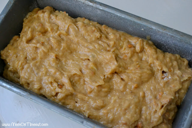 loaf pan with the banana bread batter spread out