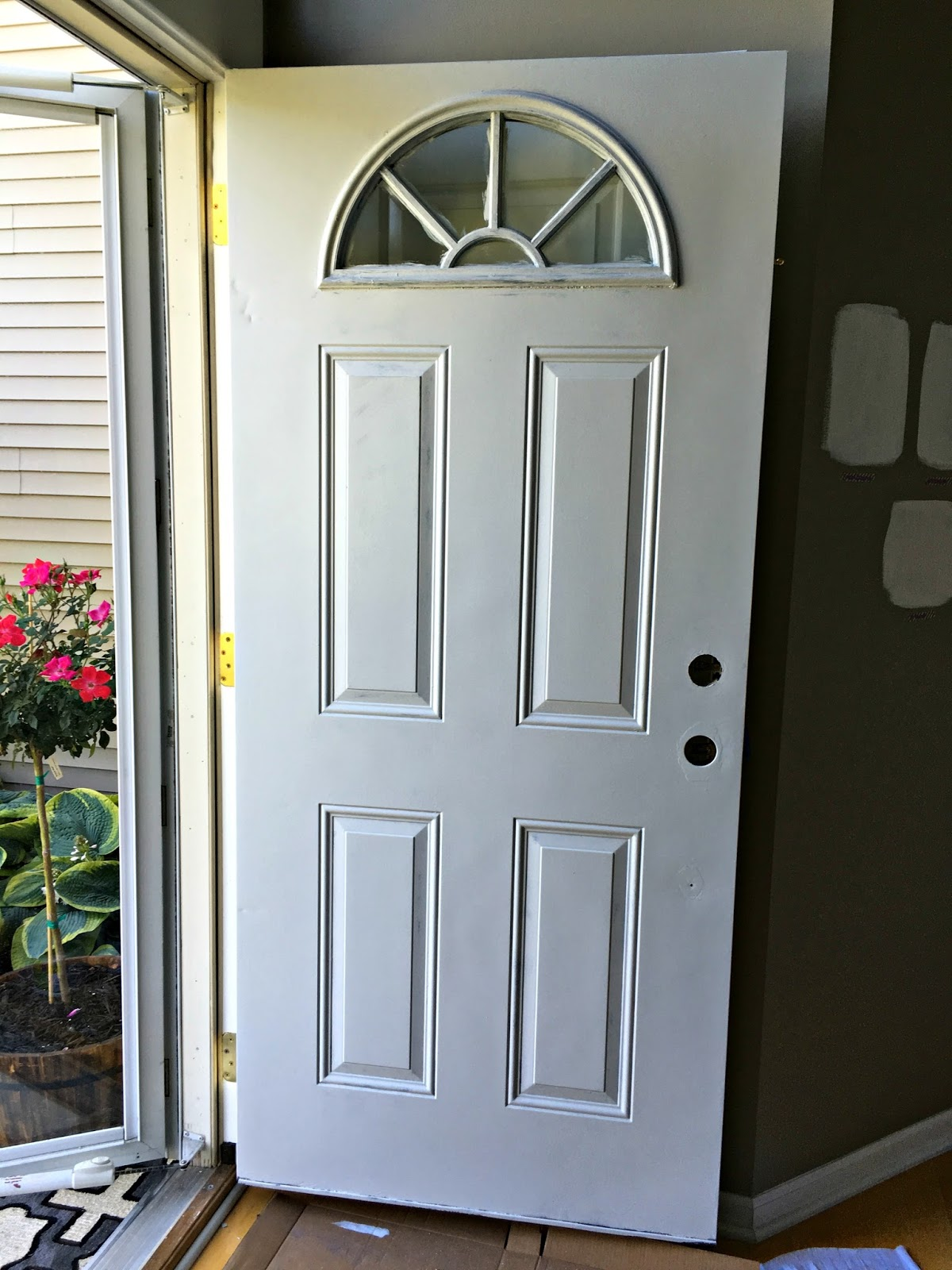 I also propped the front screen door for ventilation. Before I applied the second coat of primer I lightly sanded any stray drips. & Priming and Painting the Front Door | Restyle It Wright