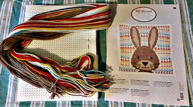 The rabbit cross stitch pattern and wool.