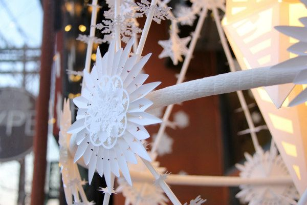 Paper snowflake ornament on a handmade all-white pajaki