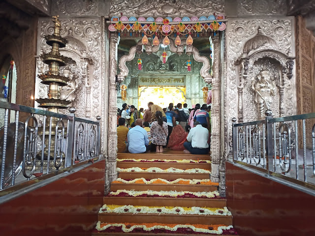 Stairs and arch leading into main shrine in Shreemant Dagdusheth Halwai Ganpati Mandir