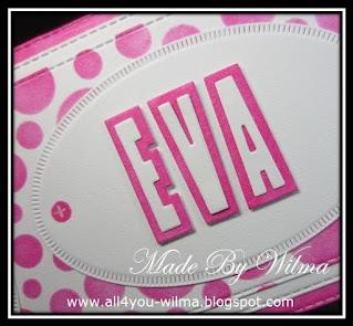 """Een close-up van """"EVA"""" met bijpassende schaduw op een wit ovaal met kleine streepjes. A close-up of """"EVA"""" with matching shadow on a white oval with small stripes."""