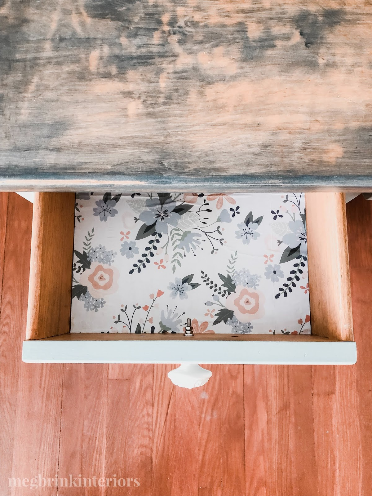 See how I added floral paper to the inside of my desk drawers for this farmhouse desk makeover!