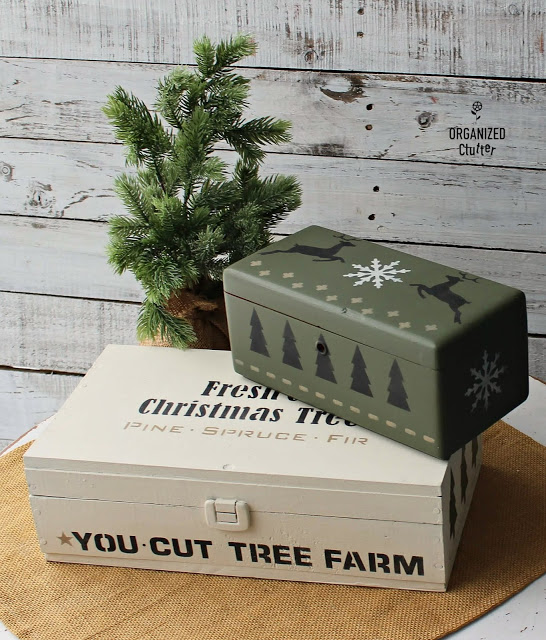 Photo of two thrifted boxes painted and stenciled as Christmas decor