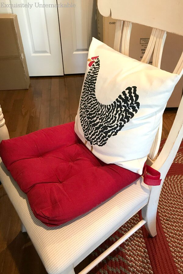 Makeshift Desk Chair with red pad and rooster pillow