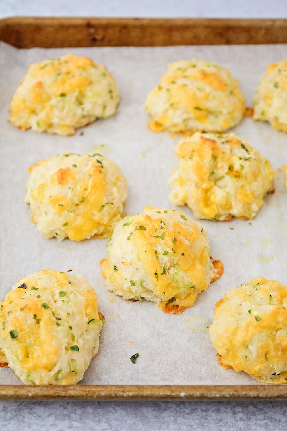 These tender and flavorful cheddar zucchini biscuits are so delicious, and quick and easy to make!