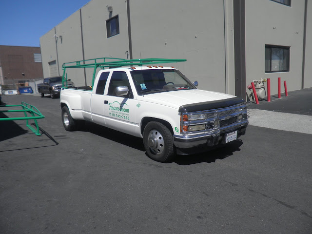 Fleet vehicles repainted with company colors and graphics at Almost Everything Auto Body