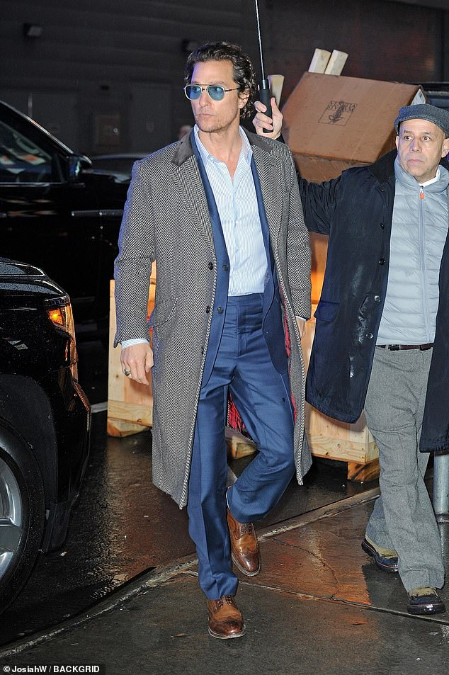 89aa99b18f45 Matt looked dapper in a navy blue suit and grey coat as he dodged the rainy  weather to appear on Good Morning America. He slicked back his curly brown  hair ...
