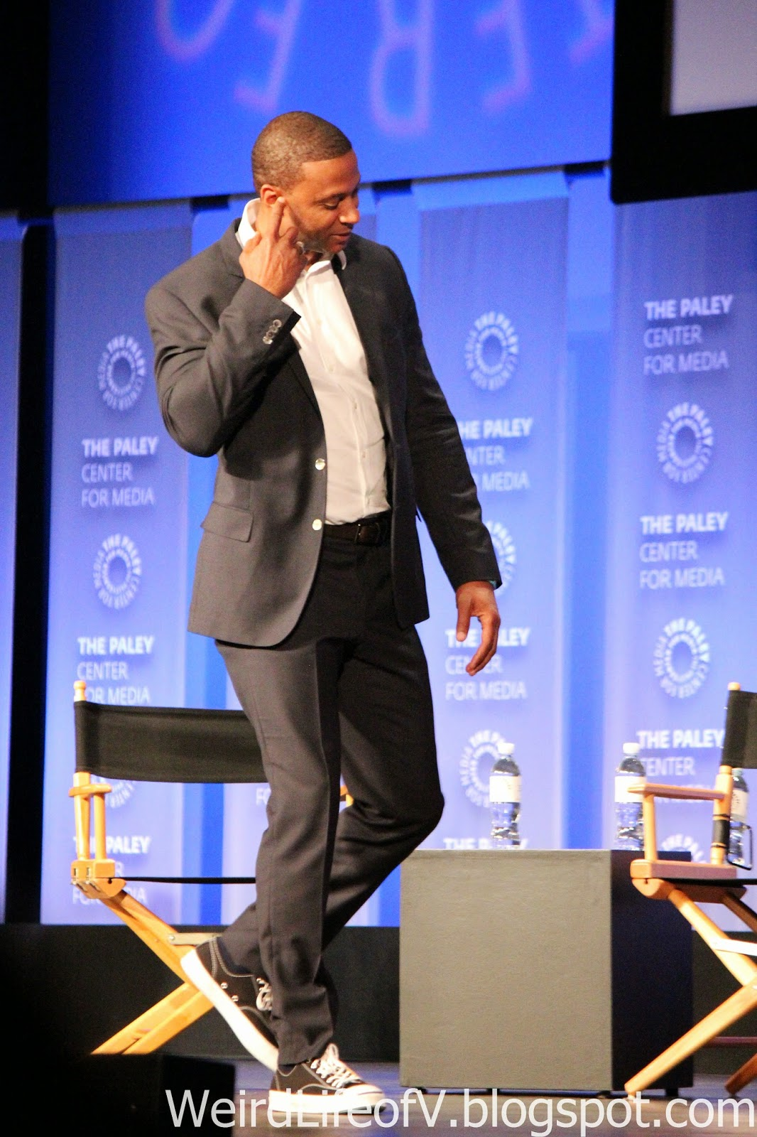 David Ramsey walking on stage