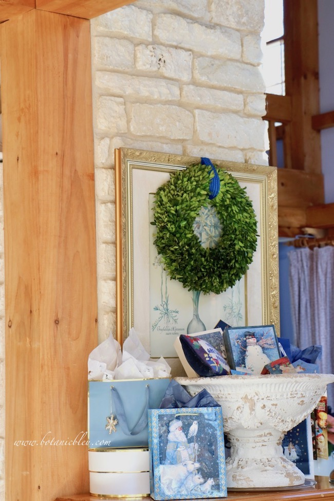 French country blue Christmas presents can be displayed in rattan baskets, large dough bowls, rustic wooden boxes, wire baskets,