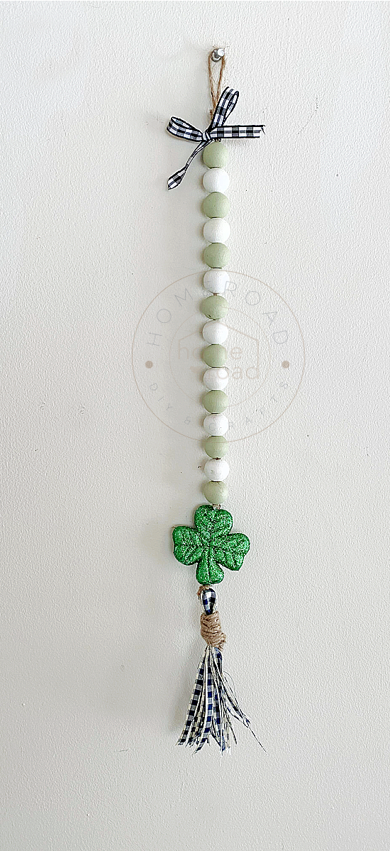 Green and white beaded garland with a shamrock and tassel