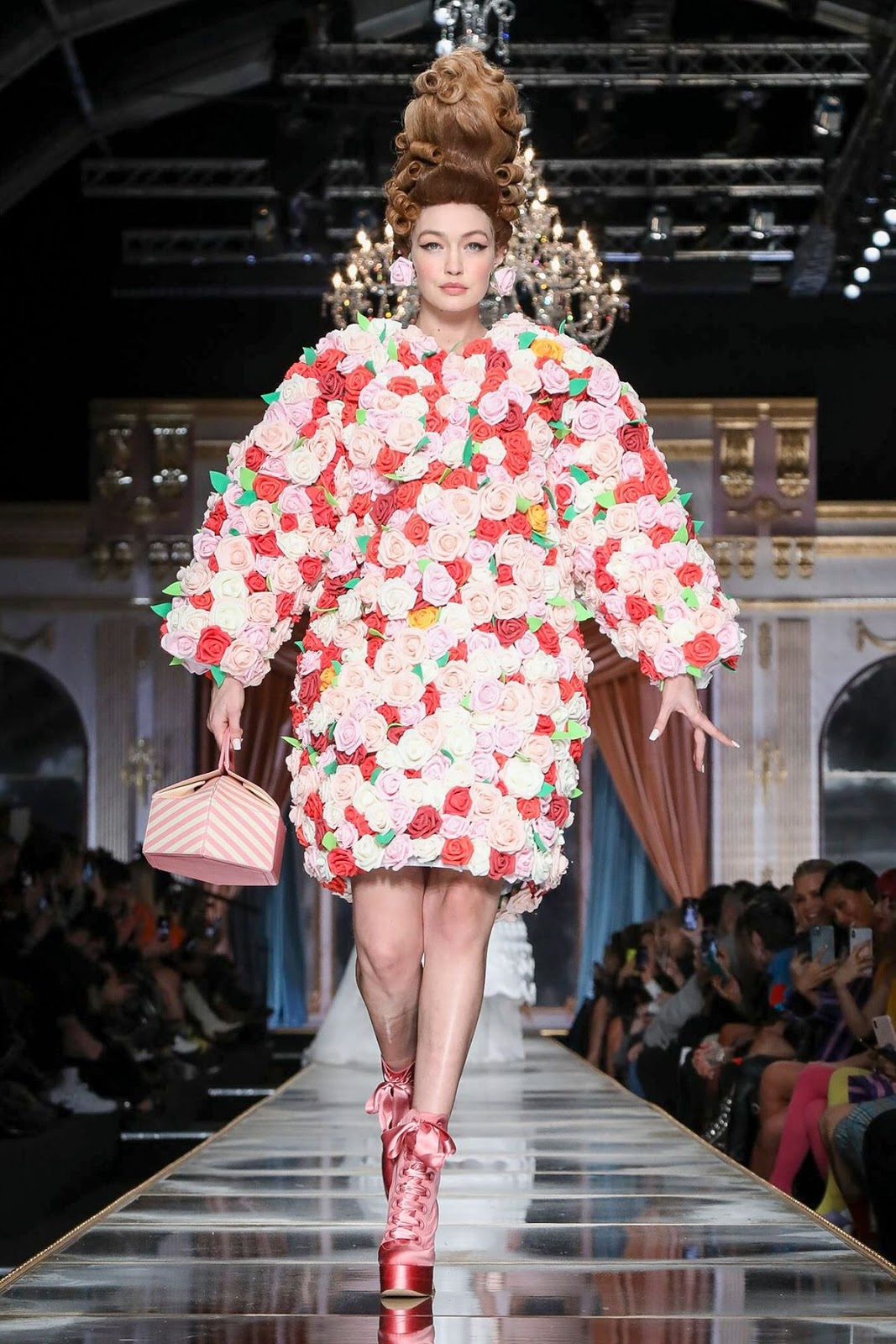 Gigi Hadid rules the runway in a rose dress for Moschino's MFW Show