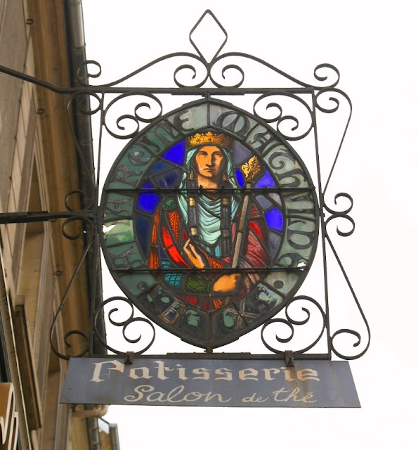 Shop sign in Bayeux, Normandy