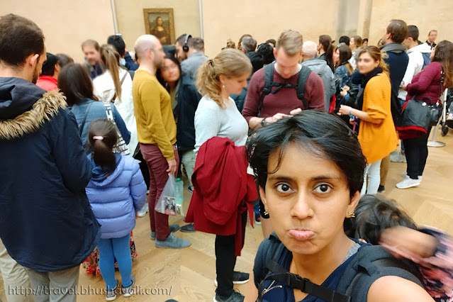 Is Mona Lisa worth seeing in Louvre?