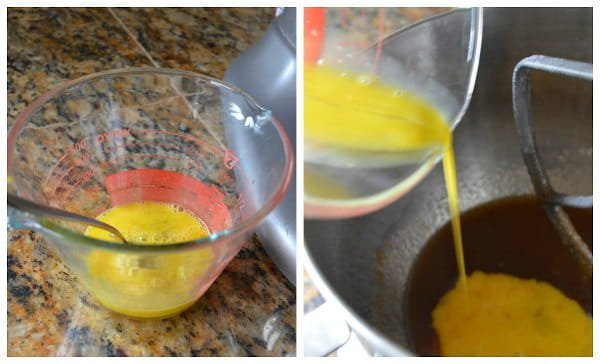 Whole eggs and egg yolks mixed together in a measuring cup and being poured into mixing bowl for Chocolate Chip Cookies