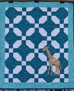 https://www.etsy.com/ca/listing/762499098/teal-blue-baby-quilt-with-giraffe