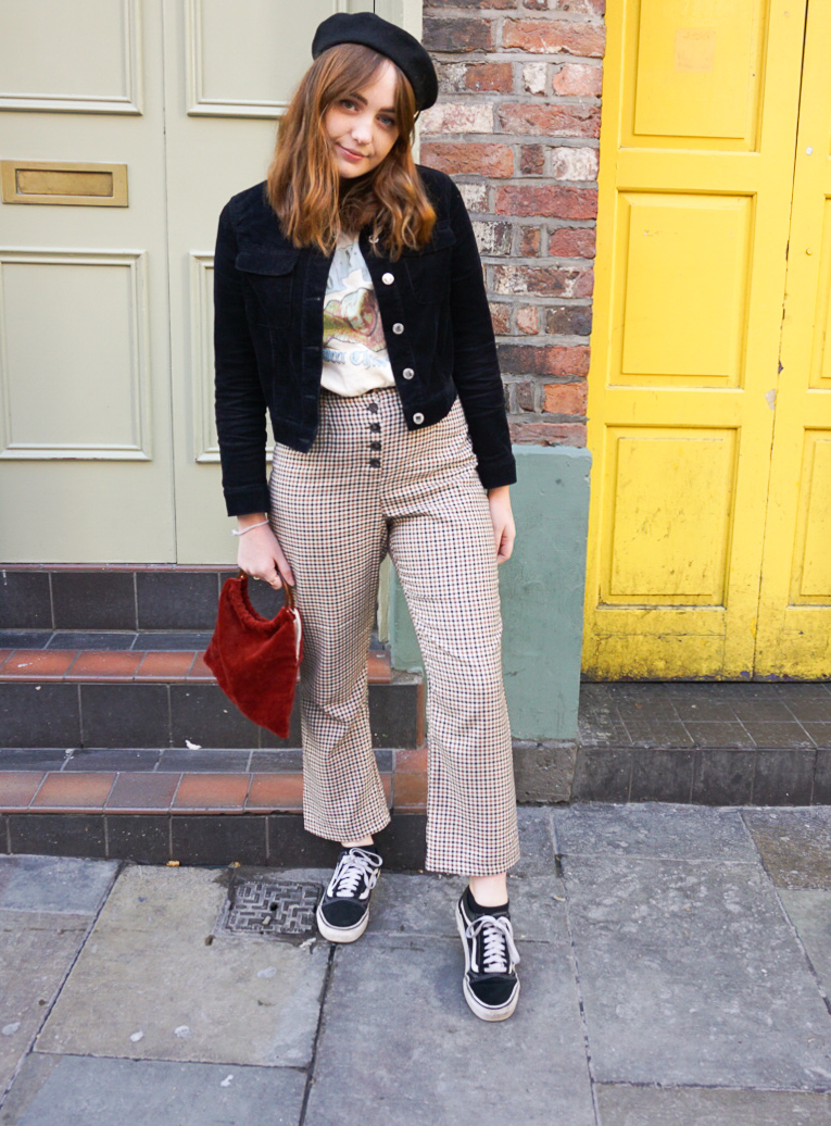 blogger wearing black beret and cord jacket, paired with band t-shirt and brown and black checked trousers for autumn 2018