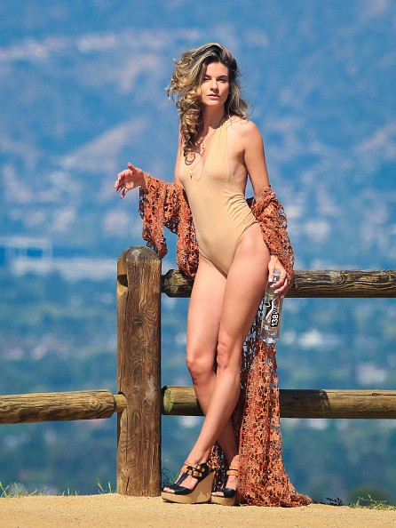 Rachel McCord poses in a plunging swimsuit for a hillside photoshoot