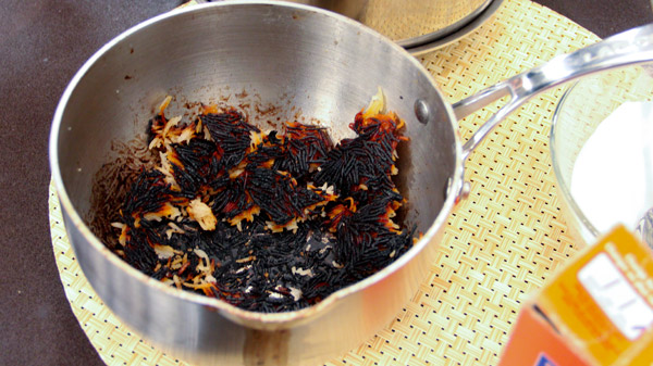 How and with what can you clean a burnt pot inside and outside?