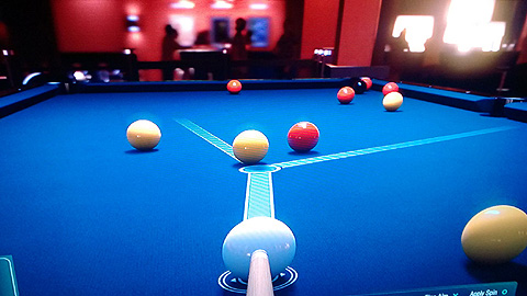 Blue table, with yellow and red balls, one black ball in the distance. Cue and white ball in the foreground.