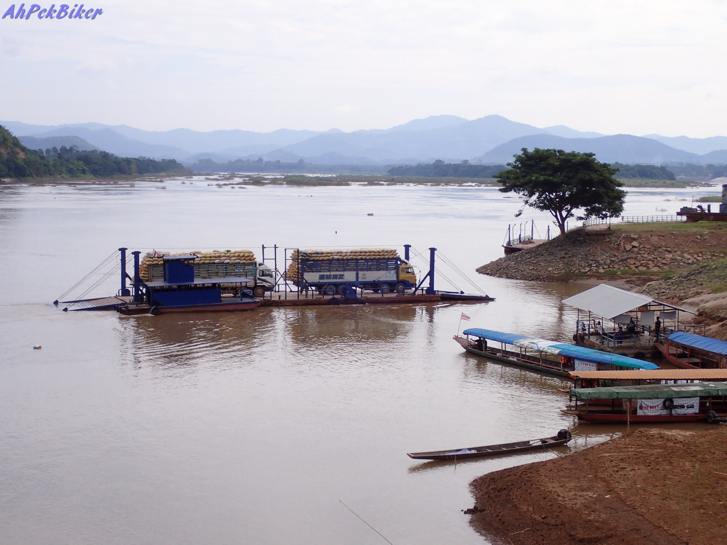 From Here Too We Could See The Ban Khok Phai Border Checkpoint. Passenger  Longboats Bring People Over From A Jetty From The Laos Side, While Large  Open Open ...