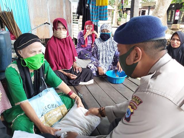 Pandemi ! Satuan Polair Polres HSU Terus Tebar Sembako di Perairan Paminggir