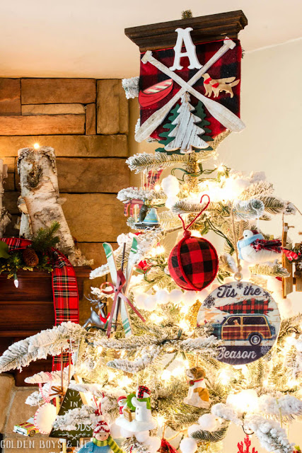 DIY family crest tree topper on flocked lodge style Christmas tree