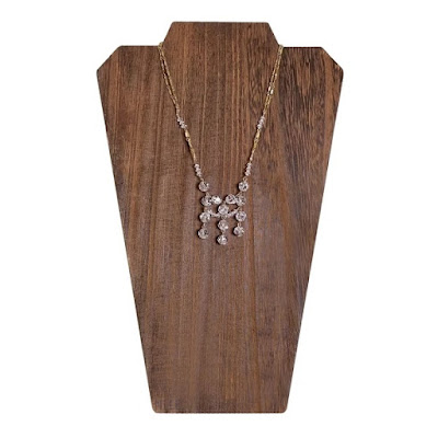 Brown Wooden Jewelry Display Bust with Easel showcasing a gold necklace
