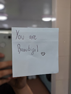 Post-it note on a mirror stating that You are Beautiful