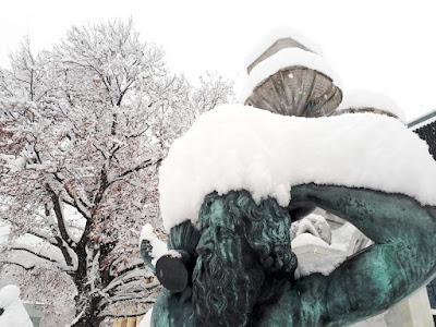 Snowy fountain in old town Innsbruck Austria