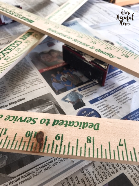 wood stick paint riser newspaper