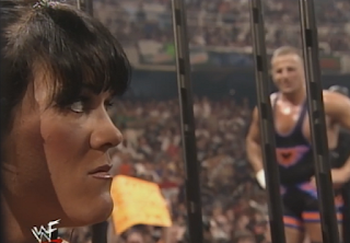 WWF -  Unforgiven 1998: In Your House 21 - Owen Hart looks on as Chyna gets put in a cage