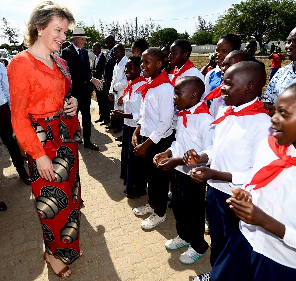 Queen Mathilde wore a red midi dress by Belgian fashion house Natan, and gold earrings by Natan