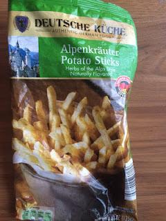 An opened bag of Deutsche Kuche Alpenkrauter Potato Sticks, from Aldi
