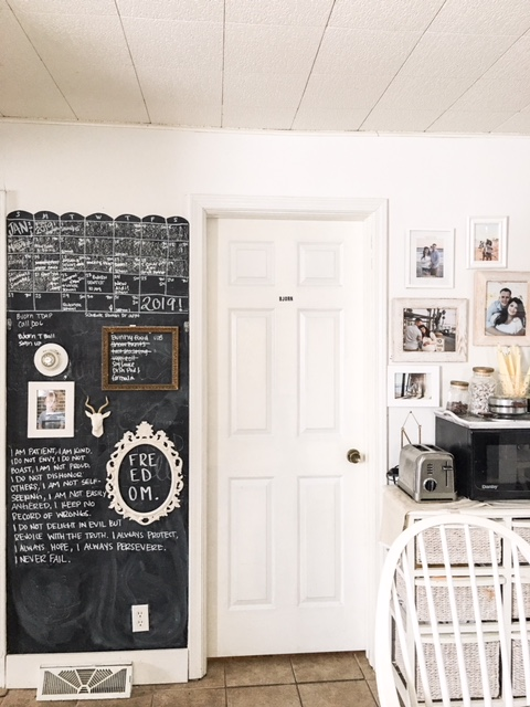 chalkboard calendar in the kitchen