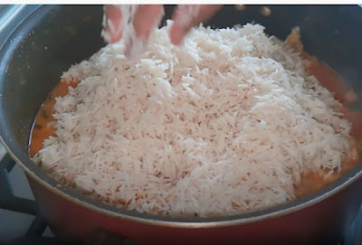 add half boiled rice to chicken biryani recipe method