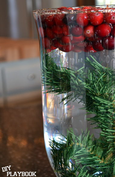 Add in some artificial greenery to the bottom of the vase.