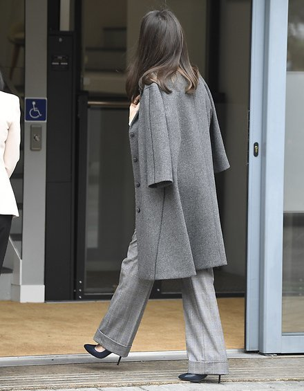 Grey swing coat from Nina Ricci, and bibosa silk bow blouse from Hugo Boss. Massimo Dutti Prince of Wales print trousers