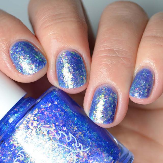 blue flakie nail polish four finger swatch
