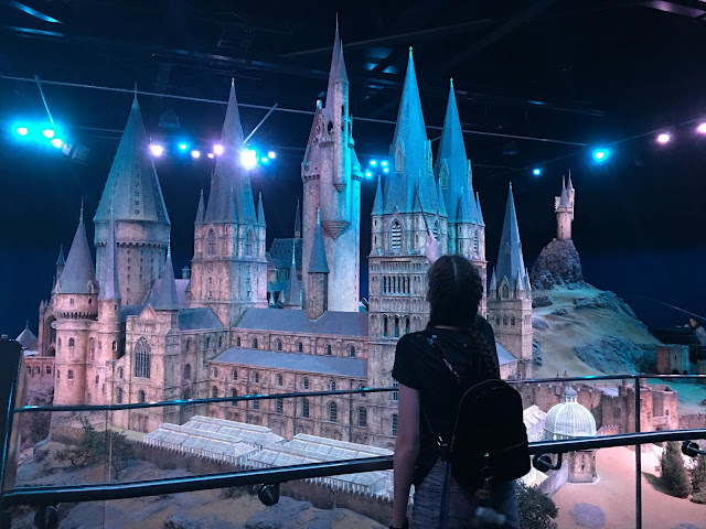 tamsin waving her wand at giant hogwarts model