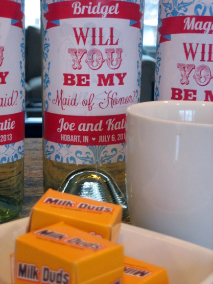 """Will you be my Bridesmaid?"" written on each bottle of wine is a sweet gift for the bridesmaids."