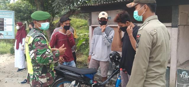 Bagikan Masker Gratis Kepada Warga Dilakukan Personel Jajaran Kodim 0207/Simalungun